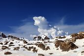 image of taurus  - Snowy rocks and sky with clouds at nice day - JPG