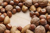 Nuts On Wooden Background