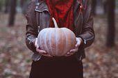 Woman Holding Big Orange Pumpkin
