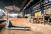 Manual forklift in industrial interior