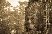 Stone Face In Ancient Bayon Temple, Angkor In Cambodia