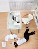 picture of workplace accident  - Exhausted Businesswoman Fainted On Floor At Workplace - JPG