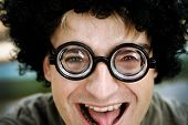 pic of bifocals  - Man wearing big wig and bifocal glasses - JPG