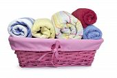 colorful towels in a wicker basket