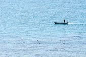 Boat On The Blue Sea