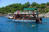 Passengers swimming around their boat