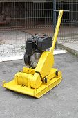 picture of vibration plate  - Yellow vibratory plate compactor at construction site - JPG