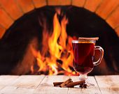 Glass Of Mulled Wine  Over Fireplace