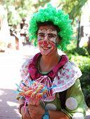 Female lolly seller in clown dress