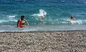 Young boys playing with waves