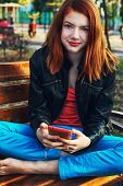 charming girl teen with phone in handk