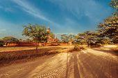 Empty Road Going Through Rural Landscape Under Sunset Sky Near Sulamani Pagoda. Myanmar (Burma)