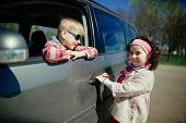 little girl and boy driving car