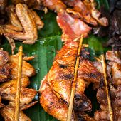 Traditional Asian Food At Market. Delicious Spicy Grilled Chicken Meat On Sticks