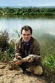 Fisherman With Fish Siberian Stargeon