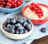 Blueberries, Red Currants Nad Cereals In Bowls