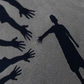 stock photo of extend  - Community support and helping children concept with shadows of a group of extended adult hands offering help or therapy to a child in need as an education symbol of social responsibility t for needy kids and teacher guidance to students who need extra car - JPG