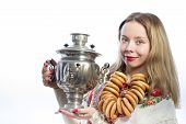 Beautiful blond young woman with tea samovar