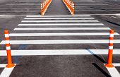 image of pedestrian crossing  - White traffic markings with a pedestrian crossing on a gray asphalt parking lot - JPG