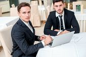 Best Work. Two Successful And Confident Businessman Sitting At The Table In A Business Office In Ful