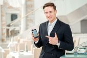 Mobile Phone A Friend For Businessman. Confident And Successful Businessman In A Strict Dress Standi