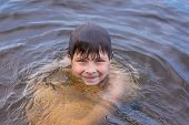 Little Boy Swimming In A Lake
