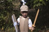 stock photo of berserk  - photo of the boy in medieval knight costume made of cardboards
