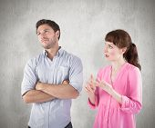 Woman arguing with uncaring man against weathered surface