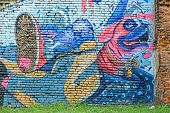 BELGRADE, SERBIA - JULY 30, 2014: colorful street art sprayed on a weathered brickwall in Belgrade. Shot in 2014