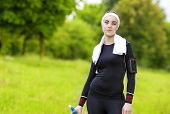 Jogging And Fitness Concept:portrait Of Smiling Caucasian Fit Woman Drinking Water Outdoors And Smil