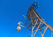 image of voltage  - High voltage electric tower against the blue sky - JPG