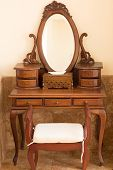Beautiful old style carwed wooden table with mirror and chair