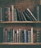 grunge bookshelf with old books.