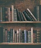 grunge bookshelf with old books.