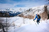 Winter sport: man skiing in powder snow. Val D'Aosta, italian Alps, Europe.