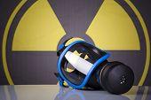image of toxic substance  - Gas mask on toxic symbol background - JPG