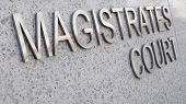 stock photo of magistrate  - Magistrates Court sign in stainless steel and stone - JPG