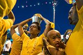 KUALA LUMPUR, MALAYSIA - FEBRUARY 3, 2015: Hindu devotees carry milk pots on their heads walking in a procession to the Batu Caves temple on Thaipusam day, a day of thanksgiving and devotion.