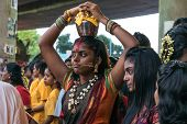 KUALA LUMPUR, MALAYSIA - FEBRUARY 3, 2015: Hindu devotees perform prayers at the Sri Mahamarriamman temple in Batu Caves. Hundreds of thousands of Hindu devotees come here for the Thaipusam prayers.