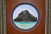 Rock In Ocean Through Porthole