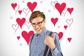 Geeky hipster showing thumbs up against white background with vignette