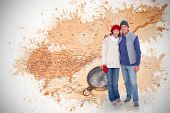 Happy couple in warm clothing against world map with compass showing north america