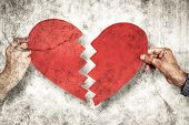 foto of two hearts  - Two hands holding broken heart against grey background - JPG