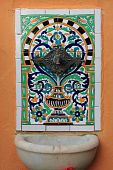 stock photo of saracen  - Ancient fountain with azulejo and old style tap - JPG