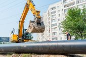 Using of excavator as crane for raising of tube