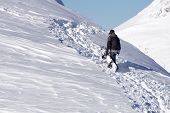 Snowboarder climbing a snowy mountain, freeride