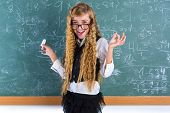 picture of clever  - Clever nerd pupil blond girl in green board student happy schoolgirl - JPG