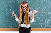 Clever nerd pupil blond girl in green board student happy schoolgirl