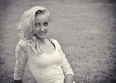 Pretty Blonde Young Woman Outdoor Laying Down On Grass