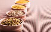 Cumin,turmeric,hops-suneli,paprika In A Wooden Bowl